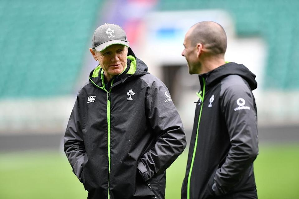 """Joe Schmidt (L) became only the third coach to guide the Irish to a Grand Slam with the simple message """"get out and play lads"""" (AFP Photo/OLLY GREENWOOD)"""