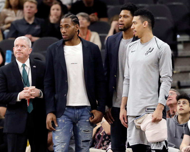 Uncertainty over Kawhi Leonard's health and long-term plans could make it less likely that the Celtics, Lakers or other suitors present the Spurs with major trade offers. (AP)