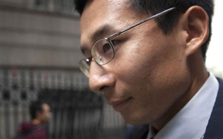 Bob Nguyen, a former employee at expert-networking firm Primary Global Research, leaves court after his sentencing in New York October 17, 2013. REUTERS/Carlo Allegri