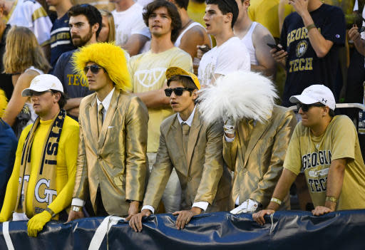 Georgia Tech students look on after North Carolina scored a touchdown during the second half of an NCAA college football game Saturday, Oct. 5, 2019, in Atlanta. (John Amis/Atlanta Journal-Constitution via AP)