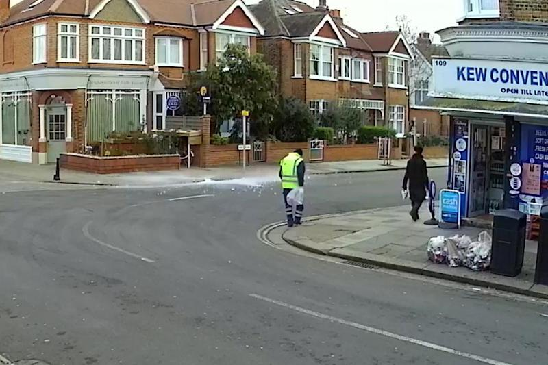The large chunk of ice smashes to the ground in front of the shocked street cleaner