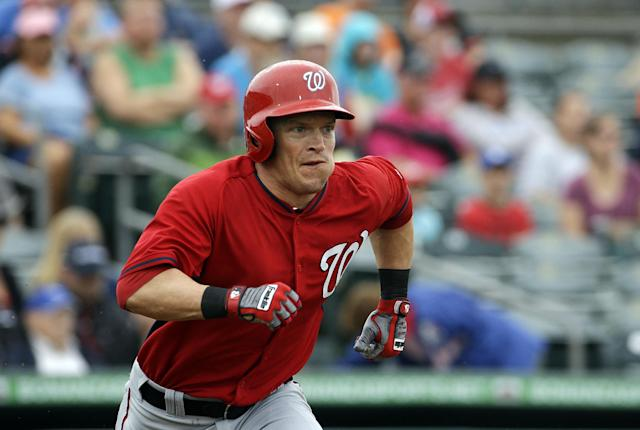 Washington Nationals' Nate McLouth runs out a double to score teammate Jeff Kobernus in the first inning of an exhibition spring training baseball game against the Miami Marlins, Monday, March 24, 2014, in Jupiter, Fla. (AP Photo/David Goldman)