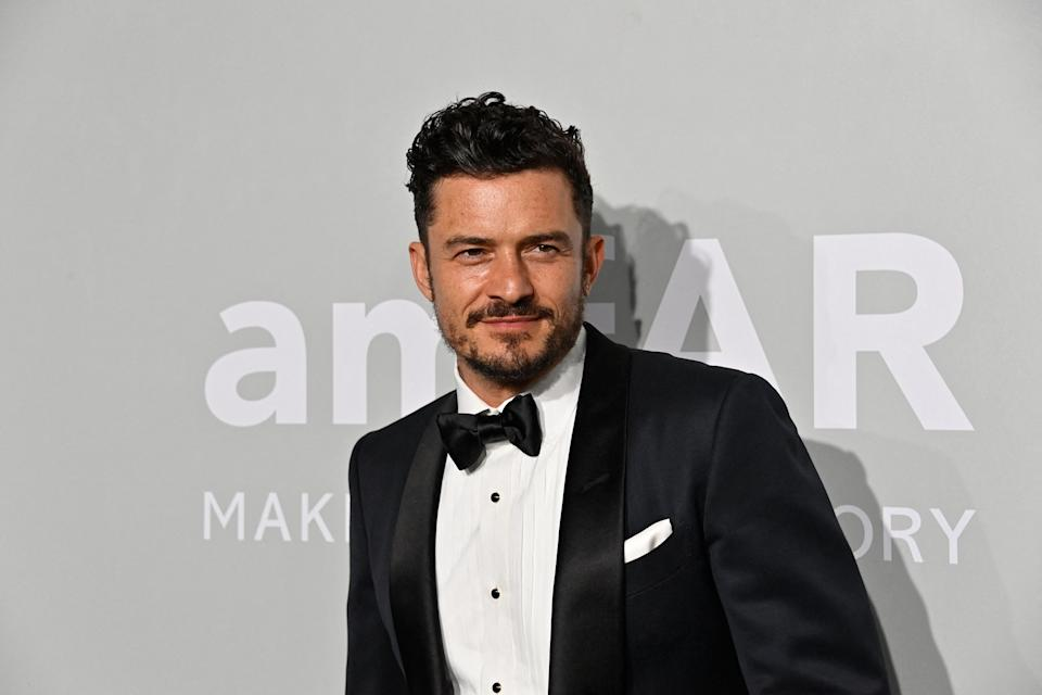 British actor Orlando Bloom arrives on July 16, 2021 to attend the amfAR 27th Annual Cinema Against AIDS gala at the Villa Eilenroc in Cap d'Antibes, southern France, on the sidelines of the 74th Cannes Film Festival. (Photo by John MACDOUGALL / AFP) (Photo by JOHN MACDOUGALL/AFP via Getty Images)