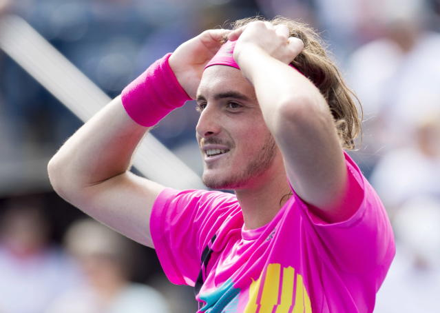 Stefanos Tsitsipas, of Greece, celebrates after defeating Novak Djokovic, of Serbia, at the Rogers Cup men's tennis tournament in Toronto, Thursday, Aug. 9, 2018. (Frank Gunn/The Canadian Press via AP)