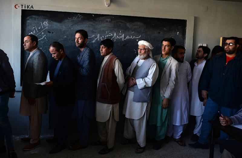 Around three million people defied the threat of militant attacks to cast their ballot in the long-delayed poll on Saturday, official figures showed, but many polling sites opened several hours late or not at all (AFP Photo/FARSHAD USYAN)