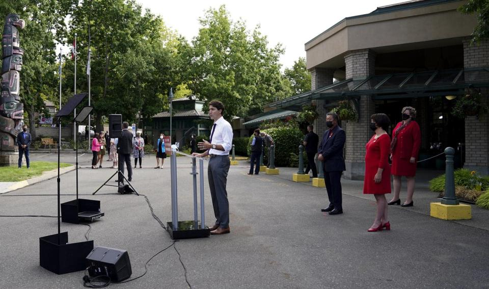 Liberal Leader Justin Trudeau standing at a microphone outside a building
