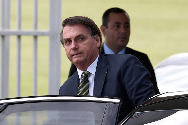 Brazilian President Jair Bolsonaro leaves Alvorada Palace in Brasilia, Brazil on April 6, 2020. - President Jair Bolsonaro's disapproval rating has surged as the far-right leader has taken a vocal stance against coronavirus containment measures, two polls out last Friday found. (Photo by EVARISTO SA / AFP) (Photo by EVARISTO SA/AFP via Getty Images)