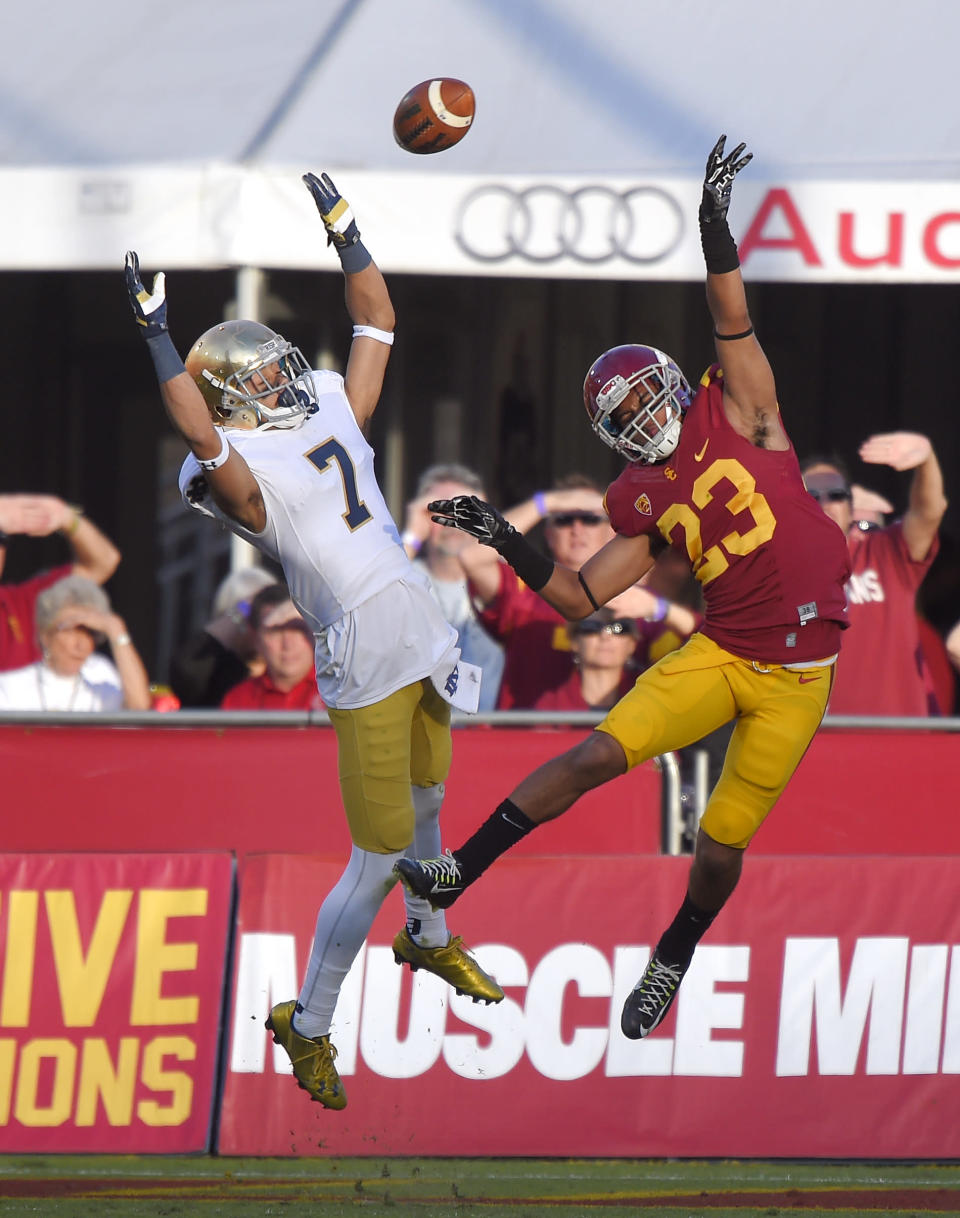 Southern California cornerback Jonathan Lockett, right, deflects a pass intended for Notre Dame wide receiver William Fuller during the second half of an NCAA college football game, Saturday, Nov. 29, 2014, in Los Angeles. Southern California won 49-14. (AP Photo/Mark J. Terrill)