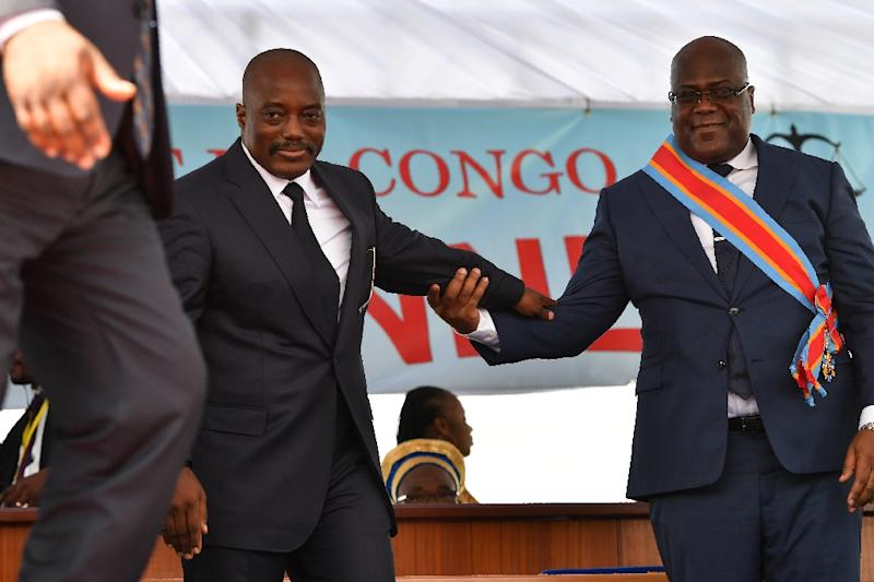 Inauguration day: Outgoing president Joseph Kabila, left, and successor Felix Tshisekedi mark DR Congo's first-ever peaceful transition of power. Kabila still overshadows the national political scene, wielding clout acquired during 18 years in office (AFP Photo/TONY KARUMBA)
