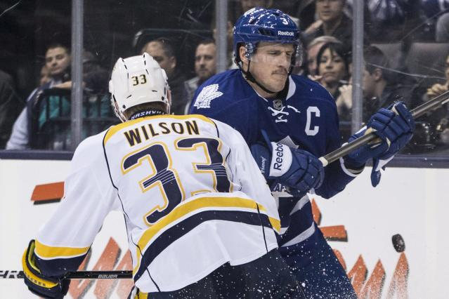 Toronto Maple Leafs' Dion Phaneuf, right, battles for the puck with Nashville Predators' Colin Wilson during the third period of an NHL hockey game, Thursday, Nov. 21, 2013 in Toronto. (AP Photo/The Canadian Press, Chris Young)
