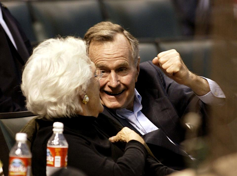 Former President George H.W. Bush and Barbara Bush enjoy a night at the park. The Houston Astros defeated the Milwaukee Brewers 2-0 on a 3-hit shutout by pitcher Roy Oswalt.