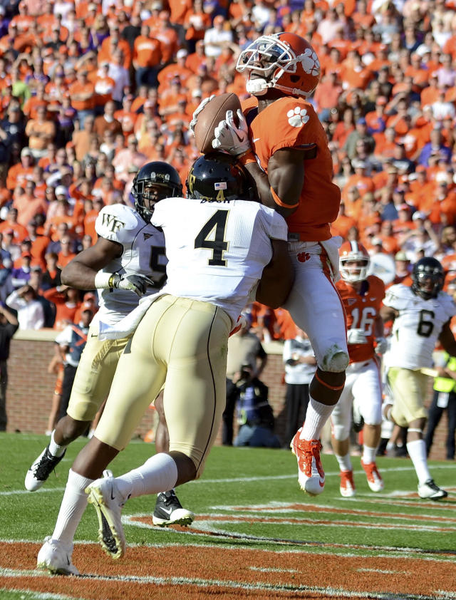 Clemson's Jaron Brown pulls in a touchdown pass over Wake Forest's Josh Bush in the fourth quarter of an NCAA college football game against Wake Forest Saturday, Nov. 12, 2011, at Memorial Stadium in Clemson, S.C. (AP Photo/ Richard Shiro)