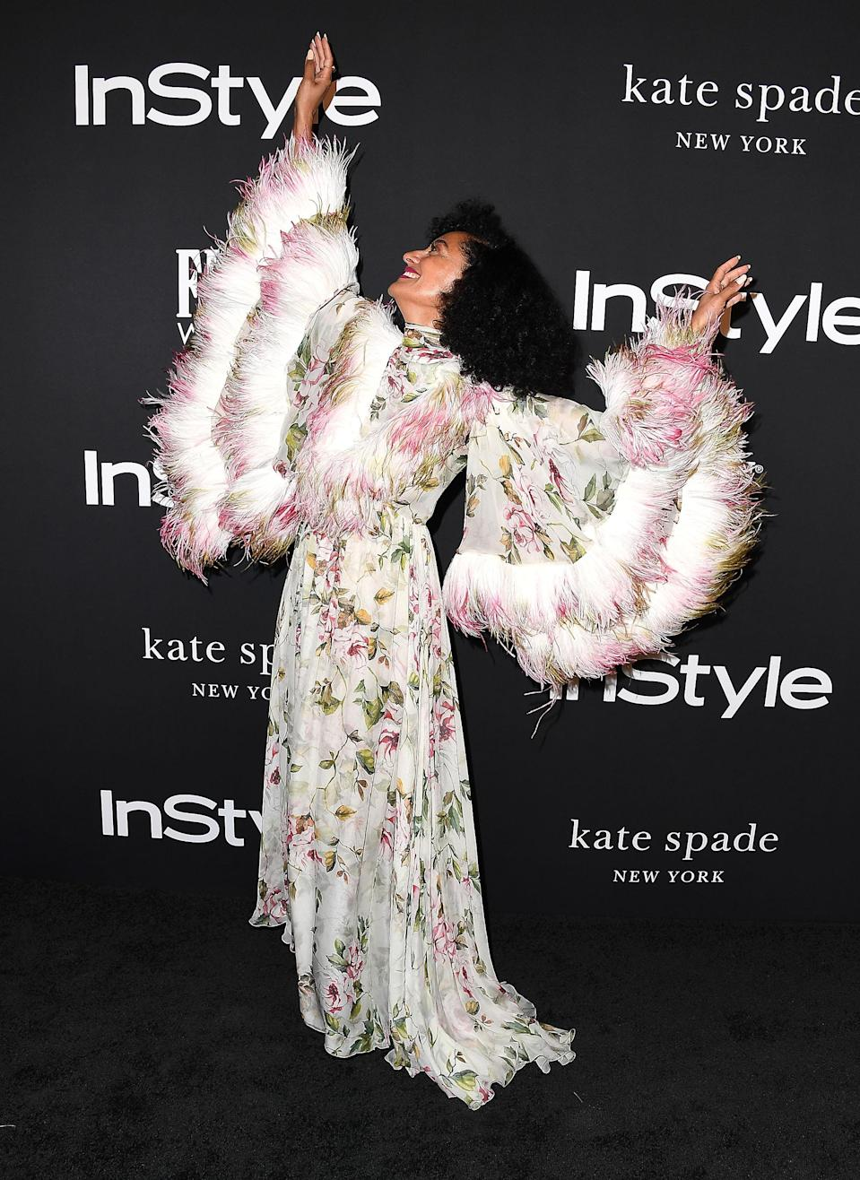 <p>'Blackish' actress – and Diana Ross' daughter – Tracee always goes the extra mile with her looks. For the InStyle Awards, the American star worked a floral dress by Giambattista Valli – which she clearly enjoyed posing in. <em>[Photo: Getty]</em> </p>