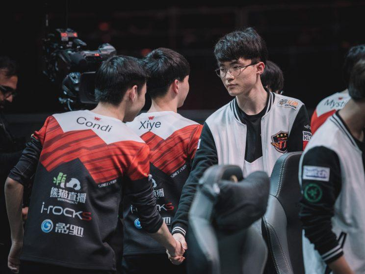 Faker shakes hands after a Group Stage loss to Team WE (lolesports)
