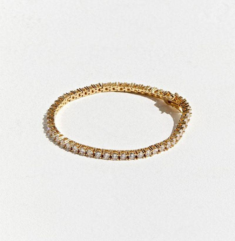 """<p><strong>SEVEN50</strong></p><p>urbanoutfitters.com</p><p><strong>$79.00</strong></p><p><a href=""""https://go.redirectingat.com?id=74968X1596630&url=https%3A%2F%2Fwww.urbanoutfitters.com%2Fshop%2Fseven50-tennis-bracelet&sref=https%3A%2F%2Fwww.esquire.com%2Fstyle%2Fmens-accessories%2Fg33325933%2Fbest-bracelets-for-men%2F"""" rel=""""nofollow noopener"""" target=""""_blank"""" data-ylk=""""slk:Buy"""" class=""""link rapid-noclick-resp"""">Buy</a></p><p>Stainless steel construction topped off with some serious stones and a sleek gold finish. </p>"""