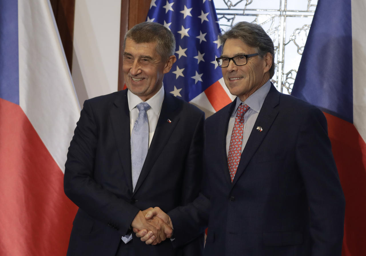 Czech Republic's Prime Minister Andrej Babis, left, shake hands with U. S. Energy Secretary Rick Perry, right, as they meet at the government headquarters in Prague, Czech Republic, Wednesday, Nov. 14, 2018. (AP Photo/Petr David Josek)