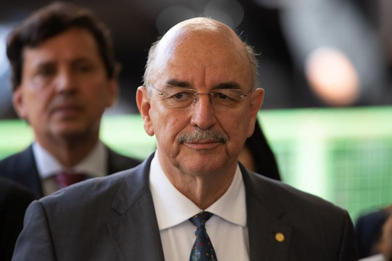 Appointed Brazilian Minister of Citizenship Osmar Terra arrives for a press conference by Brazilian President-elect Jair Bolsonaro at the headquarters of the transitional government in Brasilia on November 28, 2018. (Photo by Sergio LIMA / AFP) (Photo credit should read SERGIO LIMA/AFP via Getty Images)