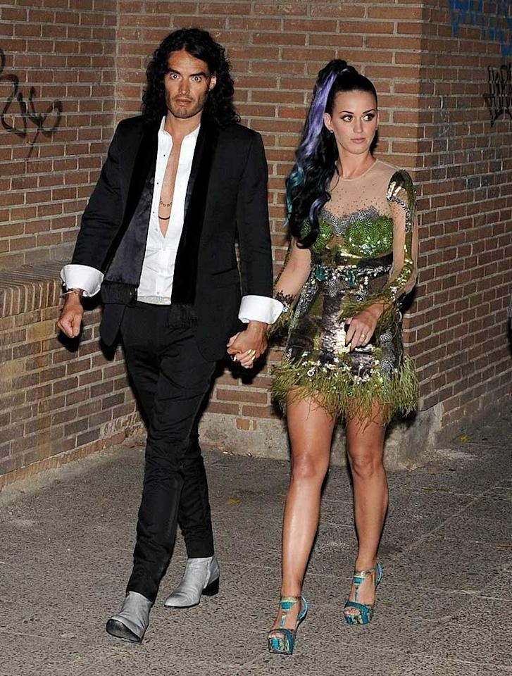"Earlier in the week, the ""Firework"" songstress and her new hubby, walking fashion disaster Russell Brand, were seen heading to dinner in Spain in these wacky, tacky ensembles. Kadena/<a href=""http://www.x17online.com"" target=""new"">X17 Online</a> - November 17, 2010"