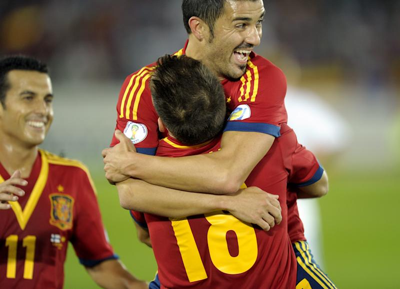 Spain's Jordi Alba, back to camera no. 18, celebrates after scoring with teammate David Villa during their World Cup group I qualifying soccer match at the Olympic Stadium in Helsinki, Friday Sept. 6, 2013. (AP Photo/Lehtikuva, Timo Jaakonaho) FINLAND OUT