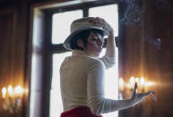 """This image released by Netflix shows Krysta Rodriguez as Liza Minnelli in a scene from """"Halston,"""" premiering Friday. (Atsushi Nishijima/Netflix via AP)"""