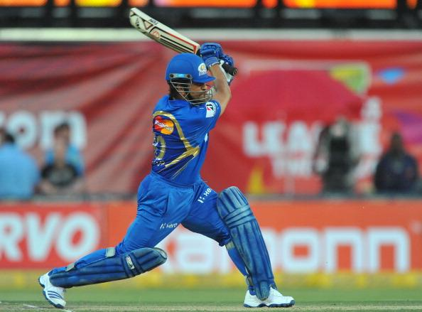 JOHANNESBURG, SOUTH AFRICA - OCTOBER 14:  Sachin Tendulkar of Mumbai drives straight during the Karbonn Smart CLT20 match between bizhub Highveld Lions and Mumbai Indians at Bidvest Wanderers Stadium on October 14, 2012 in Johannesburg, South Africa. (Photo by Duif du Toit / Gallo Images/Getty Images)