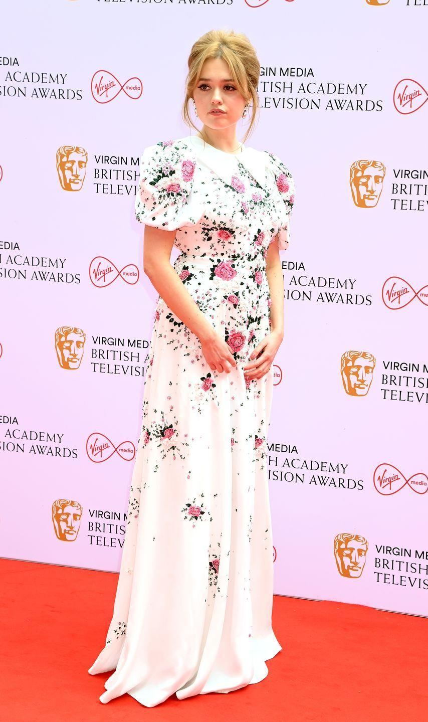 <p>Aimee Lou Wood opted for ladylike elegance, wearing a floral collared gown by Miu Miu.</p>