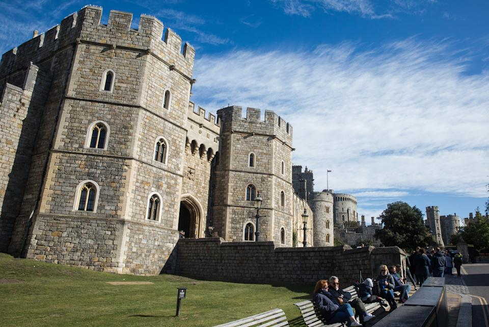 Tourists sit outside Windsor Castle where special precautions have been taken by the Royal Collection Trust to help protect visitors from the coronavirus on 26 September 2020 in Windsor, United Kingdom. The Royal Borough of Windsor and Maidenhead is aware of a rise in local coronavirus infections, has a COVID-19 outbreak management plan in place to try to ensure that the numbers do not increase further and has requested access to more coronavirus testing sites with this in mind. (photo by Mark Kerrison/In Pictures via Getty Images)