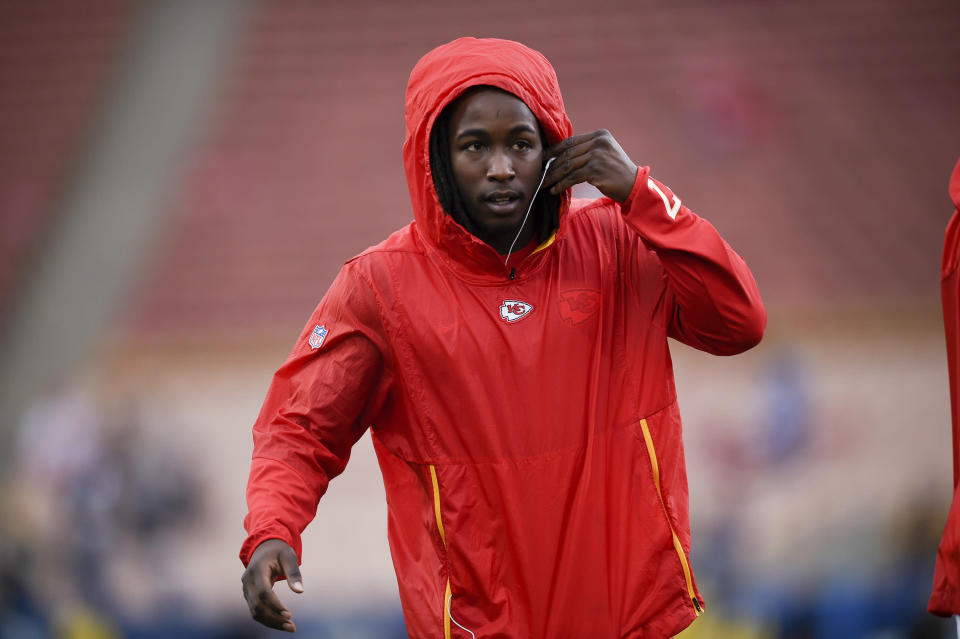"FILE - In this Nov. 19, 2018, file photo, Kansas City Chiefs running back Kareem Hunt warms up before an NFL football game against the Los Angeles Rams, in Los Angeles. The Cleveland Browns have signed Kareem Hunt, the running back cut by Kansas City in November after a video showed him pushing and kicking a woman the previous February. Cleveland general manager John Dorsey, who drafted Hunt while working for Kansas City, on Monday, Feb. 11, 2019, said the Browns ""fully understand and respect the complexity of questions and issues in signing a player with Kareem's history and do not condone his actions."" (AP Photo/Kelvin Kuo, File)"