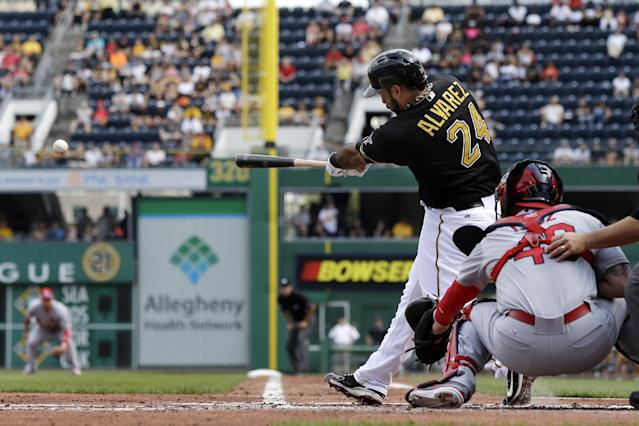 Pittsburgh Pirates' Pedro Alvarez (24) drives in a run with a double off St. Louis Cardinals starting pitcher Lance Lynn during the first inning of a baseball game in Pittsburgh Tuesday, July 30, 2013. (AP Photo/Gene J. Puskar)