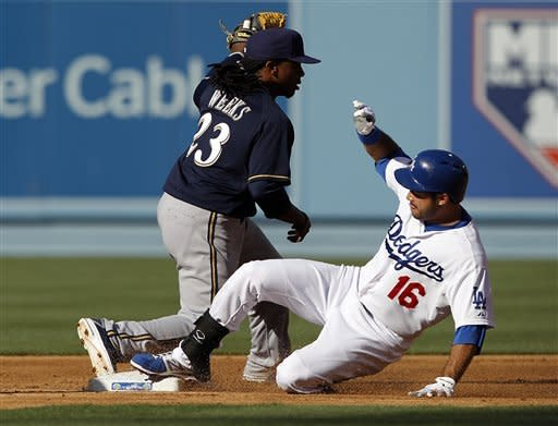 Los Angeles Dodgers Andre Ethier slides into second base ahead of Milwaukee Brewers second baseman Richie Weeks on an RBI double that scored Tony Gwynn Jr. in the inning of a baseball game in Los Angeles Monday, May 28, 2012.(AP Photo/Reed Saxon)