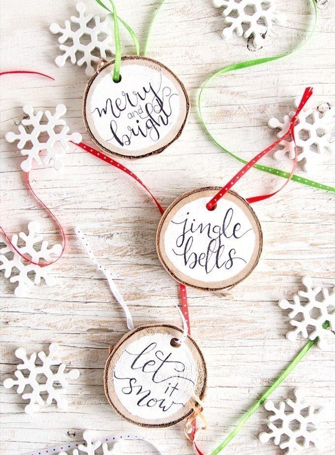 """<p>If your hand-lettering skills are up to snuff, these painted wood slices are easy to recreate. If not, use a stencil or a cutting machine to achieve the same look. </p><p><em>Get the tutorial at <a href=""""https://www.dreamalittlebigger.com/post/wood-slice-ornaments.html"""" rel=""""nofollow noopener"""" target=""""_blank"""" data-ylk=""""slk:Dream a Little Bigger"""" class=""""link rapid-noclick-resp"""">Dream a Little Bigger</a>.</em></p><p><a class=""""link rapid-noclick-resp"""" href=""""https://www.amazon.com/Wedding-Stencils-Reusable-Alphabet-Decorations/dp/B07FYL1TV4?tag=syn-yahoo-20&ascsubtag=%5Bartid%7C10072.g.34443405%5Bsrc%7Cyahoo-us"""" rel=""""nofollow noopener"""" target=""""_blank"""" data-ylk=""""slk:SHOP STENCILS"""">SHOP STENCILS</a></p>"""
