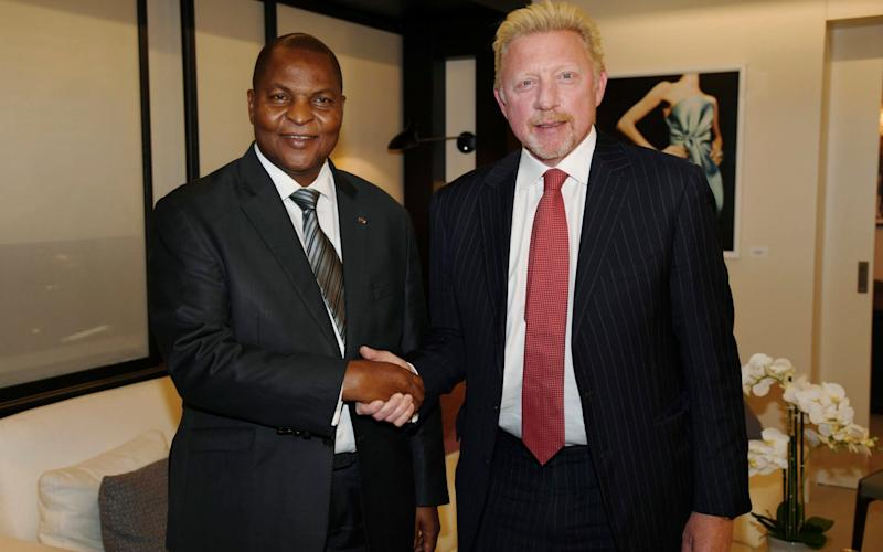 President Faustin Archange Touadera of the CAR with Boris Becker, in a picture released in April - Irle Moser Rechtsanw'lte PartG