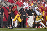 Southern California wide receiver George Farmer, left, makes a touchdown catch as Notre Dame cornerback Cole Luke defends during the first half of an NCAA college football game, Saturday, Nov. 29, 2014, in Los Angeles. (AP Photo/Mark J. Terrill)