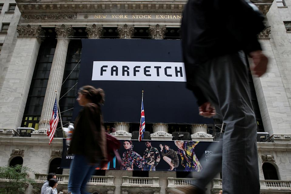 A banner to celebrate the IPO of online fashion house Farfetch is displayed on the facade of the of the New York Stock Exchange (NYSE) in New York, U.S., September 21, 2018. REUTERS/Brendan McDermid
