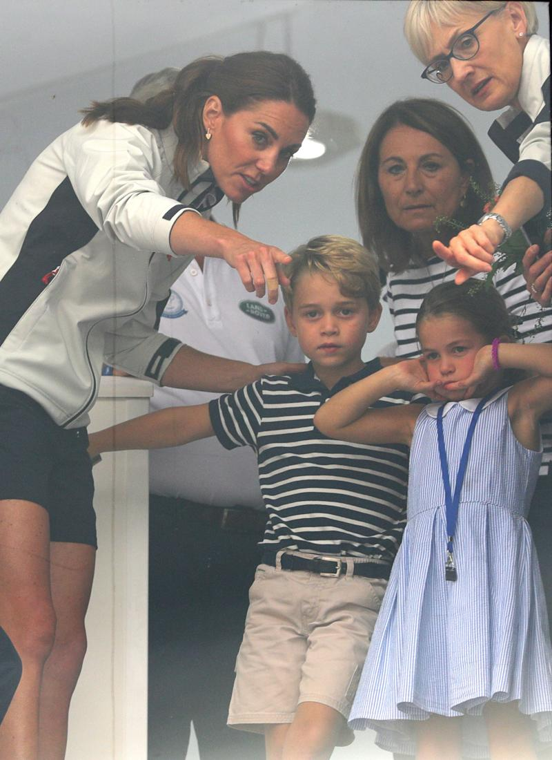 The Duchess of Cambridge with Prince George and Princess Charlotte look through a window at the prize giving after the King's Cup regatta at Cowes on the Isle of Wight. (Photo by Aaron Chown/PA Images via Getty Images)