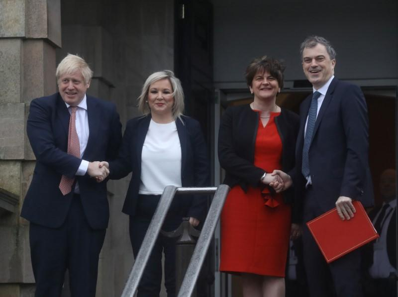 Britain's PM Johnson poses for photographs with Deputy first minister O'Neill, First Minister Foster and Northern Ireland Secretary of State, Smith, in Belfast