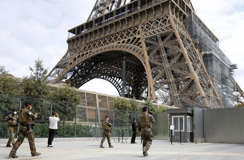 PARIS, FRANCE - JULY 15: French soldiers patrol next to the Eiffel Tower on the day of the reopening of the top floor on July 15, 2020 in Paris, France. After nearly three months of closure due to the coronavirus pandemic (COVID-19), the Eiffel Tower today opens its 3rd floor to the public. (Photo by Chesnot / Getty Images)