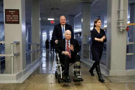 Sen. John McCain heads to the Senate floor ahead of votes on Capitol Hill in Washington, U.S., December 6, 2017. REUTERS/Aaron P. Bernstein