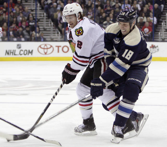 Columbus Blue Jackets' RJ Umberger, right, tries to steal the puck from Chicago Blackhawks' Duncan Keith during the first period of an NHL hockey game on Friday, April 4, 2014, in Columbus, Ohio. (AP Photo/Jay LaPrete)
