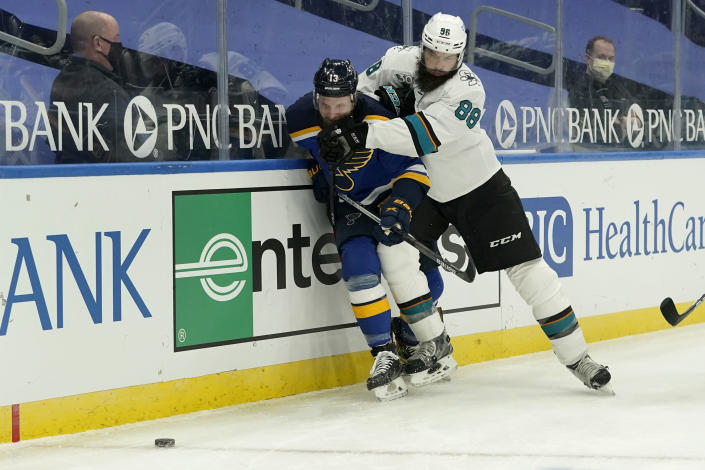 San Jose Sharks' Brent Burns (88) checks St. Louis Blues' Kyle Clifford (13) during the second period of an NHL hockey game Monday, Jan. 18, 2021, in St. Louis. (AP Photo/Jeff Roberson)