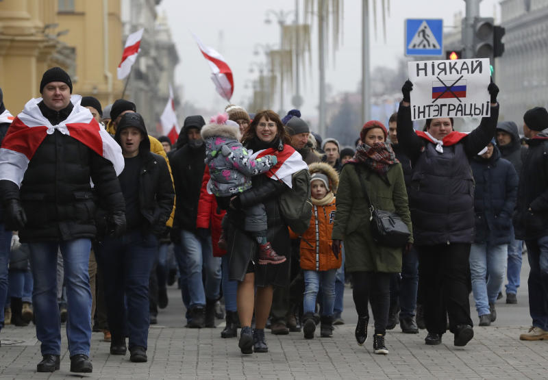 Protesters attend the procession in downtown Minsk, Belarus, Saturday, Dec. 7, 2019. More than 1,000 opposition demonstrators are rallying in Belarus to protest closer integration with Russia. Saturday's protest in the Belarusian capital comes as Belarusian President Alexander Lukashenko is holding talks with Russian President Vladimir Putin in Sochi on Russia's Black Sea coast. (AP Photo/Sergei Grits)