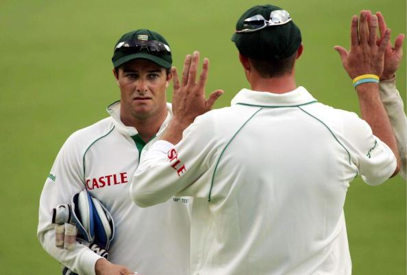 CENTURION, SOUTH AFRICA - JANUARY 11:  Mark Boucher is congratulated for taken the most catches in Test match history (367) by Andre Nel during Day One of the First Test match between South Africa and Pakistan at SuperSport Park on January 11, 2007 in Centurion, South Africa. (Photo by Lee Warren/Gallo Images/Getty Images)
