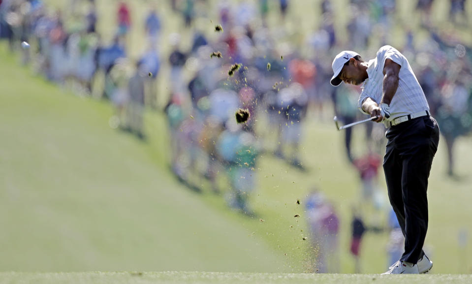 <p>Tiger Woods hits off the first fairway during the third round of the Masters golf tournament Saturday, April 7, 2012, in Augusta, Ga. (AP Photo/Chris O'Meara) </p>