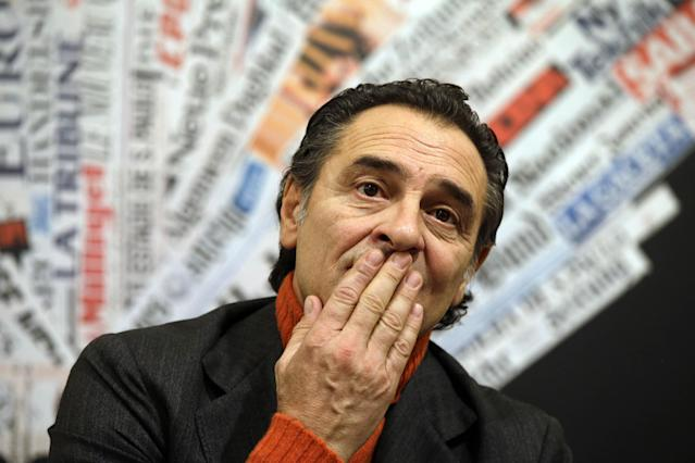 """Italy's Coach Cesare Prandelli touches his mouth during a press conference at the foreign press club in Rome, Tuesday, Dec. 3, 2013. Italy coach Cesare Prandelli is hoping for a law change that would allow children of immigrants to play for the country's national teams before they turn 18. That's a chance that Mario Balotelli never had. Speaking at the Foreign Press Association on Tuesday, Prandelli says """"other nations are ahead of us in this department. I think and hope that soon these new Italians will have a chance to gain citizenship."""" Under current law, children of legal immigrants born in Italy can only apply for citizenship once they turn 18. (AP Photo/Gregorio Borgia)"""