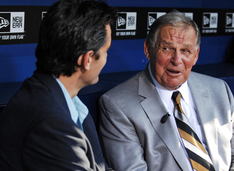 Former Atlanta Braves manager Bobby Cox is interviewed by broadcaster Chip Carey before he is honored by the team in a pregame ceremony retiring his No. 6 before a baseball game against the Chicago Cubs, Friday, Aug. 12, 2011, at Turner Field in Atlanta.  (AP photo/Dave Tulis)