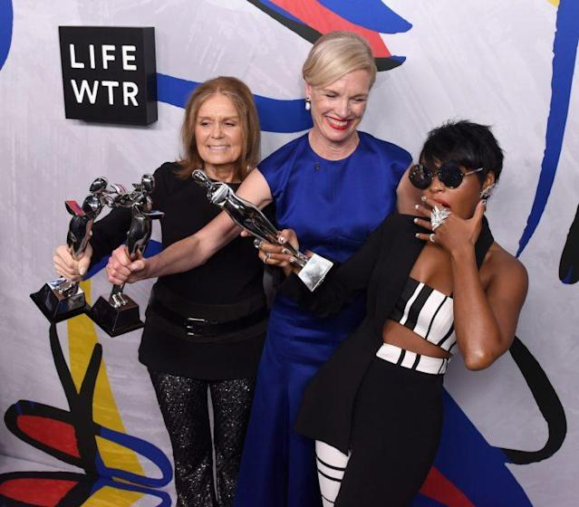 Gloria Steinem, Cecile Richards, and Janelle Monae posing with their Board of Directors' Tribute Award. (Photo: Getty Images)
