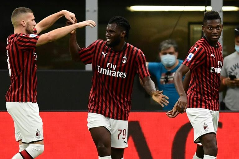 Franck Kessie (C) earned AC Milan a precious point at Napoli (AFP Photo/Miguel MEDINA)