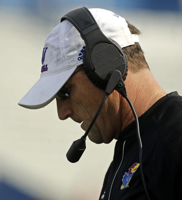 Kansas head coach David Beaty watches during the first half of an NCAA college football game against Central Michigan, Saturday, Sept. 9, 2017, in Lawrence, Kan. (AP Photo/Charlie Riedel)