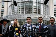 Supporters of NXIVM cult leader Keith Raniere, speak to reporters following the sentencing hearing in the sex trafficking and racketeering case against Raniere, outside the Brooklyn Federal Courthouse in New York