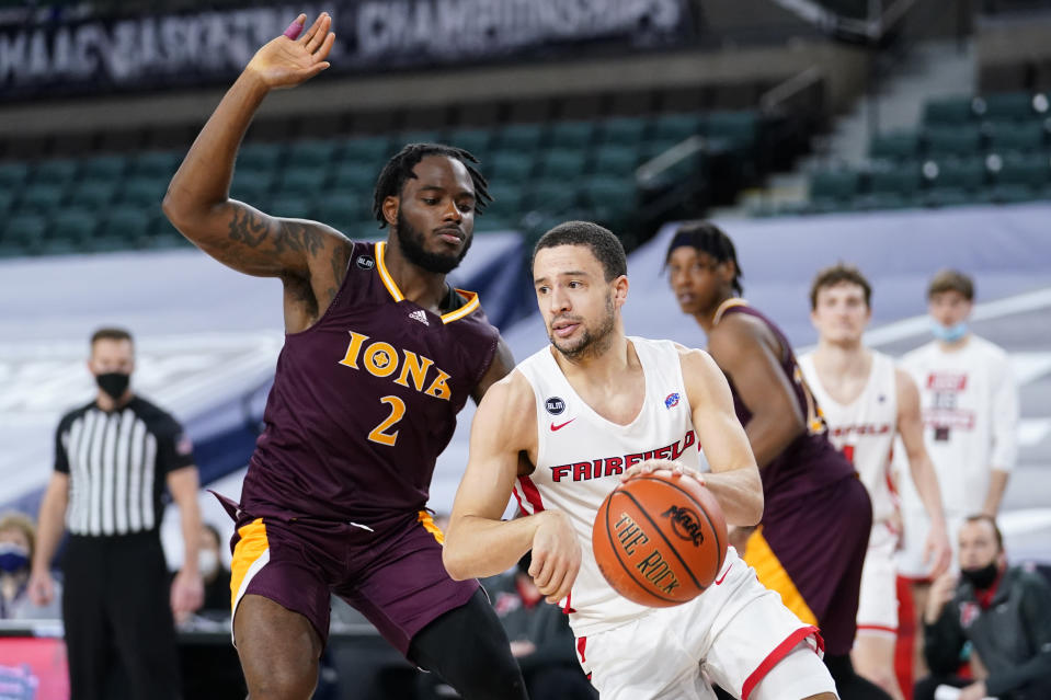 Fairfield's Caleb Green, right, dribbles past Iona's Asante Gist in the second half of an NCAA college basketball game during the finals of the Metro Atlantic Athletic Conference tournament, Saturday, March 13, 2021, in Atlantic City, N.J. (AP Photo/Matt Slocum)